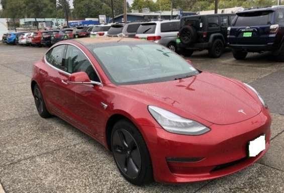 Tesla model 3 red color 2019